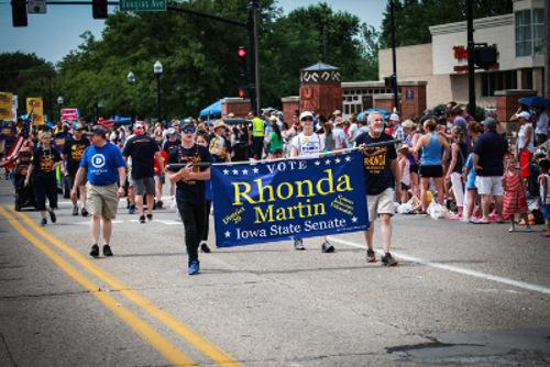 rhonda martin banner in parade
