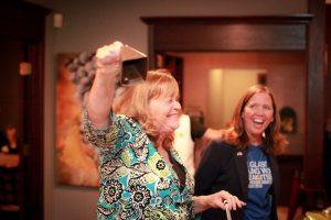 Rhonda Martin ringing cowbell to kick off campaign